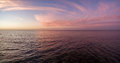 Aerial panorama of sunset over ocean. Nothing but sky, clouds an Royalty Free Stock Photo