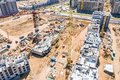 Aerial panoramic view of city construction site with tower cranes and other building machinery Royalty Free Stock Photo