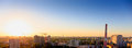 Aerial panoramic view of evening sunset cityscape, industrial area Royalty Free Stock Photo