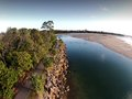 Aerial picture image of noosa spit by break water alongside river along rock wall and bike track and walking trail for holiday Royalty Free Stock Photos