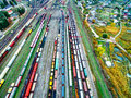 Aerial shoot of railway tracks with lots of wagons Royalty Free Stock Photo