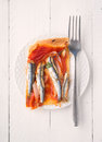 Aerial shoot shot of baked sardines ration on puff pastry with fork Stock Images