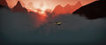 Aerial of small airplane flying through rough mountain landscape at sunset Stock Photos