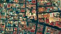 Aerial top down view to mosaic pattern of residential area roofs. Almeria, Spain Royalty Free Stock Photo