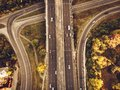 Aerial or top view from drone to road junction, freeway and bridge and car traffic in big city, urban transportation concept Royalty Free Stock Photo