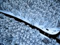 Aerial top view of road in winter forest
