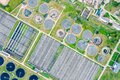 Aerial top view of modern wastewater treatment plant. circles of sedimentation tanks and aeration basins Royalty Free Stock Photo