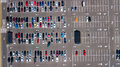 Aerial top view of parking lot with many cars from above, transportation concept Royalty Free Stock Photo
