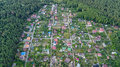 Aerial top view of residential area summer houses in forest from above, countryside real estate and dacha village in Ukraine Royalty Free Stock Photo
