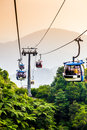 Aerial tramway moving up in tropical jungle mountains Stock Images