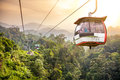 Aerial tramway moving up in tropical jungle mountains Stock Photos