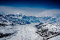 Aerial view alaskan glacier leading up to mt mckinley spewing out snow clouds great alaskan wilderness denali national park alaska Royalty Free Stock Photography