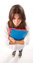 Aerial view of an angry schoolgirl isolated image young girl holding some folders Stock Photo