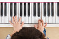 Aerial view of Asian Chinese little boy playing piano Royalty Free Stock Photo