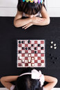 Aerial view of Asian Chinese little sisters playing chess togeth Royalty Free Stock Photo