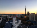 Aerial view of Auckland city skyline at sunrise