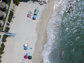Aerial view of a beach with canoes, boats and umbrellas Royalty Free Stock Photo