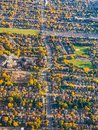Fall in the City. Aerial View of a colorful autumn foliage in housing developments Royalty Free Stock Photo