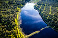 Aerial view of beautiful evening in the nature. Forest and lake from a drone Royalty Free Stock Photo