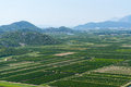 Aerial view of beautiful neretva valley in southern croatia with numerous crop fields and hills distance Royalty Free Stock Images