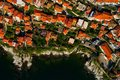 Aerial view the city of Kavala in northern Greek, ancient aquedu