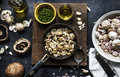 Aerial view of cooked mushroom in pan on wooden background Royalty Free Stock Photo