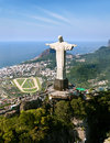 Aerial view of corcovado mountain and christ the redemeer in rio redeemer with de janeiro s atlantic background Royalty Free Stock Image