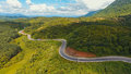 Aerial view of crooked path of road on the mountain, Shot from drone Royalty Free Stock Photo
