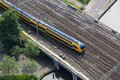 Aerial view of dutch train crossing a bridge over a canal at Stock Photos