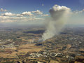 Aerial view of a fire smoke seen from plane Royalty Free Stock Images