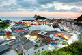 Aerial view of a fishing village at dawn on northern coast of Taipei Taiwan Royalty Free Stock Photo