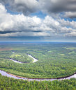 Aerial view of forest river which is on woodland in the rainy summer day during a flight Stock Image