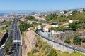 Aerial view of funchal and highway build against the mountains of madeira island portugal Royalty Free Stock Photography
