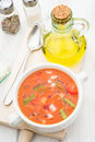 Aerial view of gazpacho soup with oil and spoon in white bowl Royalty Free Stock Photo