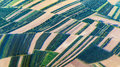 Aerial view of green fields and slopes Royalty Free Stock Photo
