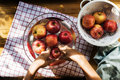 Aerial view of hands washing apples in bowl Royalty Free Stock Photo