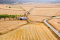Aerial view of harvested wheat fields and farm Royalty Free Stock Photo