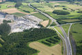 Aerial view : Highway and a quarry in countryside Stock Photo
