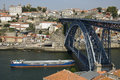 Aerial view of historic center of the city porto portugal monumental arched luis i bridge across douro river on which a cargo ship Royalty Free Stock Photography