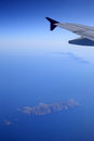 Aerial view of island in aegean sea navy blue Royalty Free Stock Images
