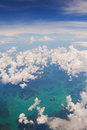 Aerial view of island airplane fly above land and ocean Stock Photography
