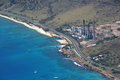 Aerial view of kahe point power plant along the ocean with highw sits highway road and boats in water on ewa side oahu hawaii Royalty Free Stock Image