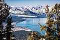 Aerial view of Lake Tahoe on a sunny winter day, Sierra mountains covered in snow visible in the background, California Royalty Free Stock Photo