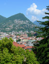 Aerial view of lugano switzerland with surrounding swiss alps Royalty Free Stock Images