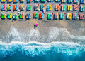 Aerial view of lying woman with swim ring in the sea Royalty Free Stock Photo