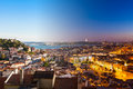 Aerial view montage of lisbon rooftop from senhora do monte view viewpoint miradouro fromn day to night in portugal Royalty Free Stock Images