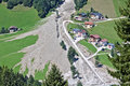 Aerial view of mountain stream in the Austrian Alps blocked after a massive mudflow with excavator and truck working to clean up Royalty Free Stock Photo
