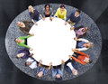 Aerial view of multiethnic people around the table Stock Photo