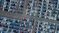 Aerial view new cars parking for sale stock lot row, New cars dealer inventory import export business commercial global, Royalty Free Stock Photo
