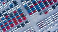 Aerial view new cars for sale stock lot row, New  Cars dealer inventory import export business logistic global Royalty Free Stock Photo